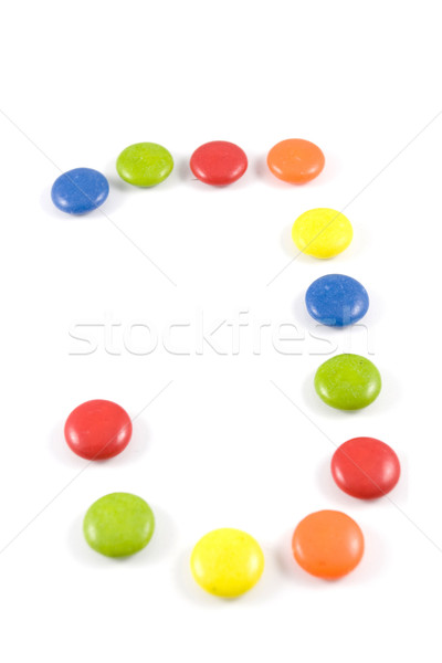 Letter J made of colored chocolates Stock photo © hsfelix