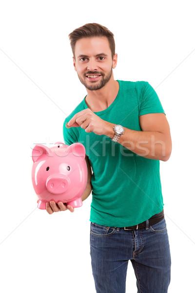 Idő mentés nyugdíj fiatalember tart persely Stock fotó © hsfelix
