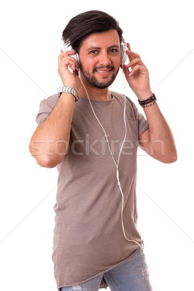 Adam mutlu genç kulaklık müzik Stok fotoğraf © hsfelix