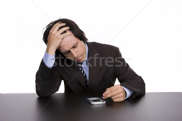 Jonge zakenman werken pda geïsoleerd witte Stockfoto © hsfelix