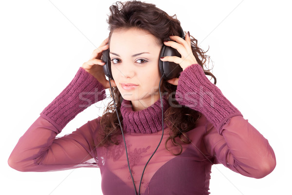 Young woman listening to music Stock photo © hsfelix