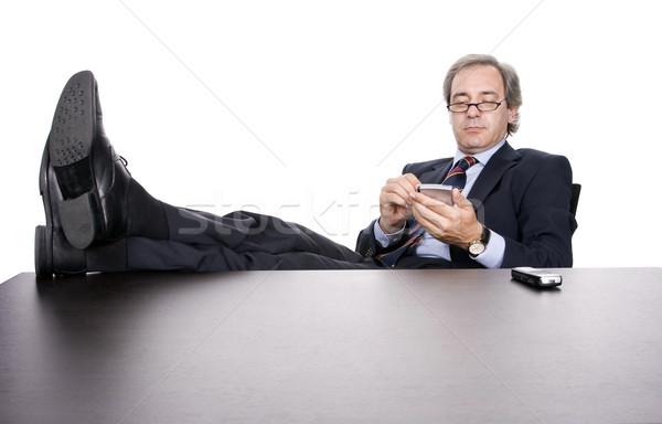 Maturo imprenditore lavoro pda isolato bianco Foto d'archivio © hsfelix