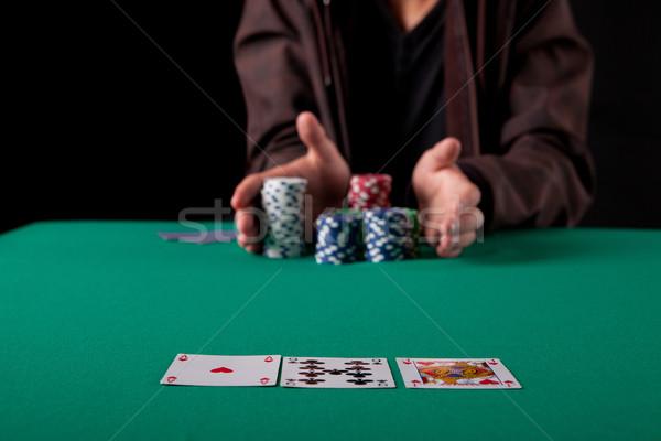 Homem jovem homem bonito jogar Texas dinheiro Foto stock © hsfelix