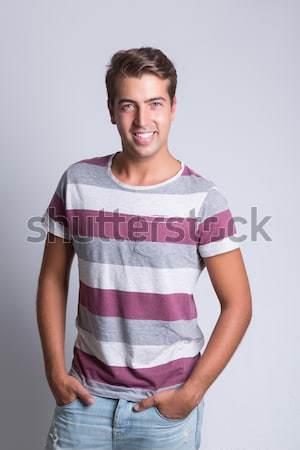 Férfi fiatal jóképű férfi pózol boldog divat Stock fotó © hsfelix