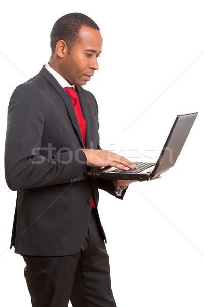 Africano homem de negócios jovem trabalhando laptop computador Foto stock © hsfelix