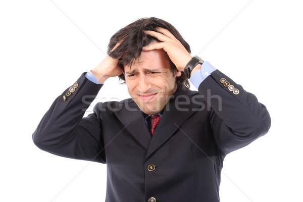 worried young businessman pulling the hair Stock photo © hsfelix