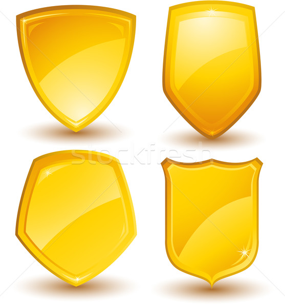 Golden shields Stock photo © hugolacasse