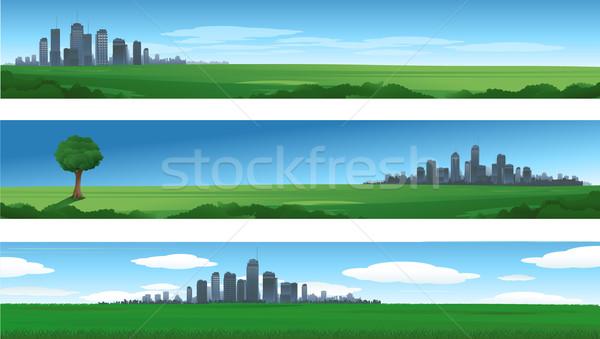 Paisagens urbanas silhuetas edifício pôr do sol fundo urbano Foto stock © hugolacasse