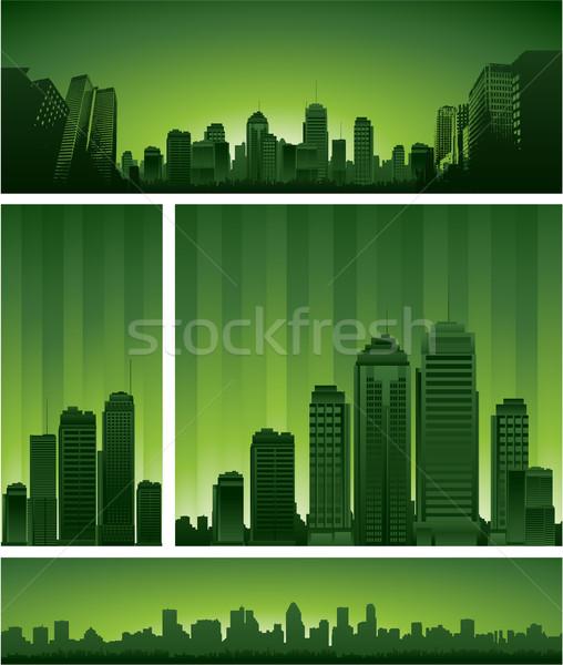 Városképek sziluettek épület naplemente háttér városi Stock fotó © hugolacasse