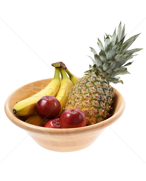 Wooden fruit bowl with a pinapple banannas and apples isolated on white background Stock photo © hyrons