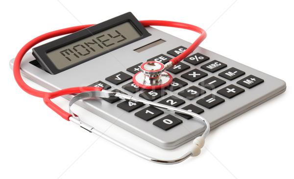 Tıbbi kırmızı stetoskop büyük hesap makinesi yalıtılmış Stok fotoğraf © hyrons