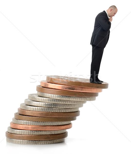 Stock photo: A businessman looking over the fiscal cliff.