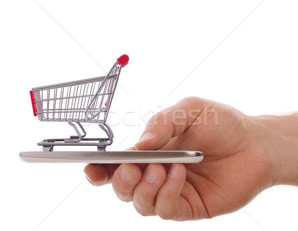 Hareketli alışveriş alışveriş sepeti cep telefonu yalıtılmış beyaz Stok fotoğraf © hyrons