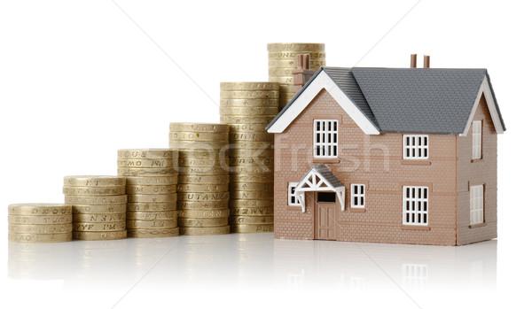 Tulajdon érték ház érmék izolált fehér Stock fotó © hyrons