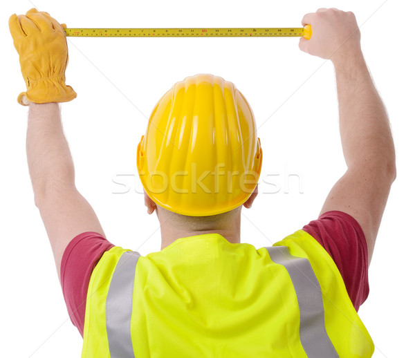 Bouw maatregel bouwvakker meetlint geïsoleerd witte Stockfoto © hyrons
