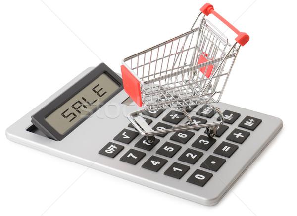 Vásárlás eladó bevásárlókocsi számológép izolált fehér Stock fotó © hyrons