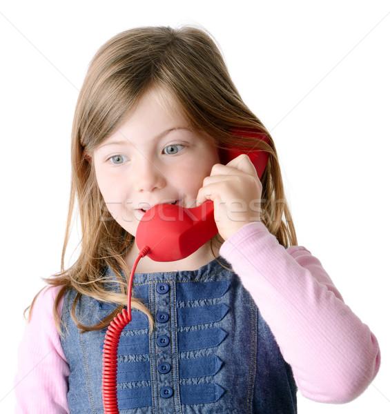 Fiatal lány beszél telefon boldog izolált fehér Stock fotó © hyrons