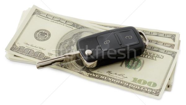 Autó pénz slusszkulcs köteg izolált fehér Stock fotó © hyrons