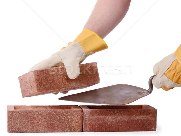 Inşaat tuğla yalıtılmış beyaz işçi Stok fotoğraf © hyrons