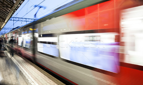 Motion blurred speed moving railroad train at railway station platform Stock photo © ia_64