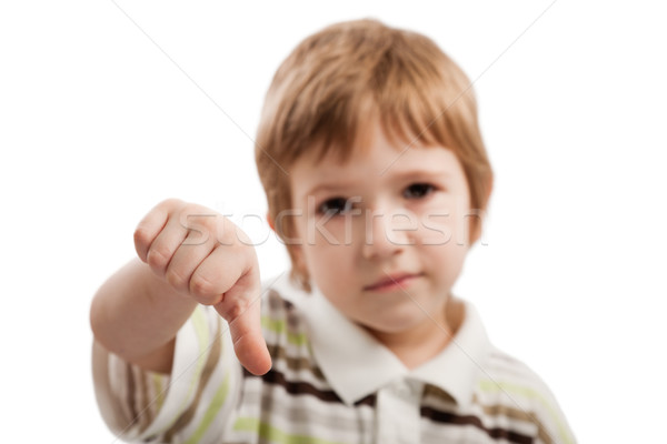 Child gesturing thumb down Stock photo © ia_64