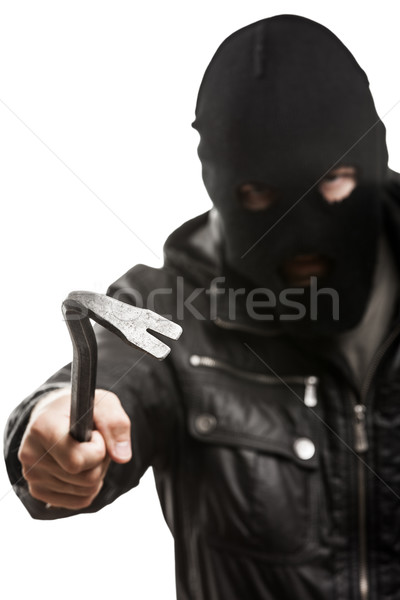 Criminal thief or burglar man in balaclava or mask holding crowb Stock photo © ia_64
