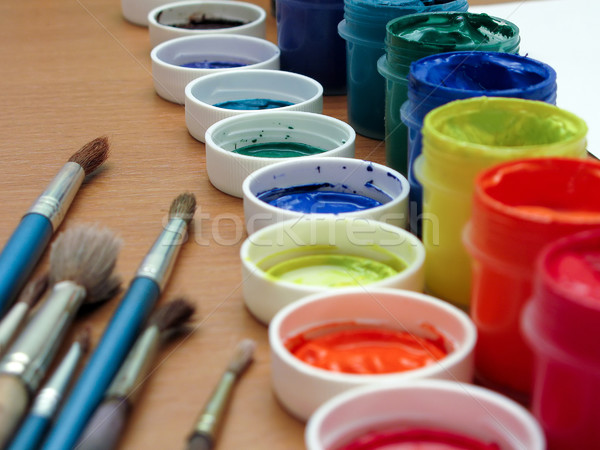 Brushes and paints on table Stock photo © ia_64