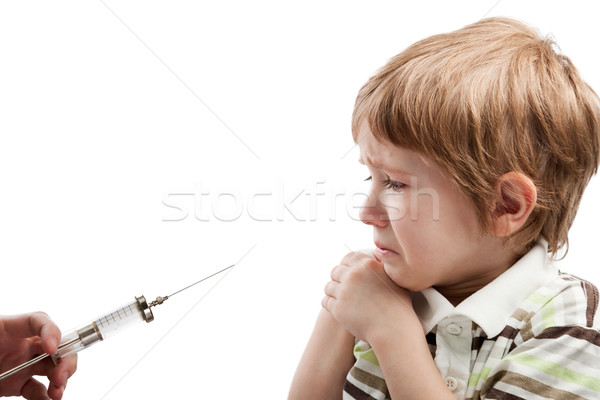 Stock photo: Syringe injecting child