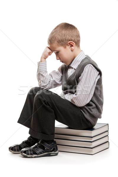 Pensatore bambino seduta lettura libri perplesso Foto d'archivio © ia_64