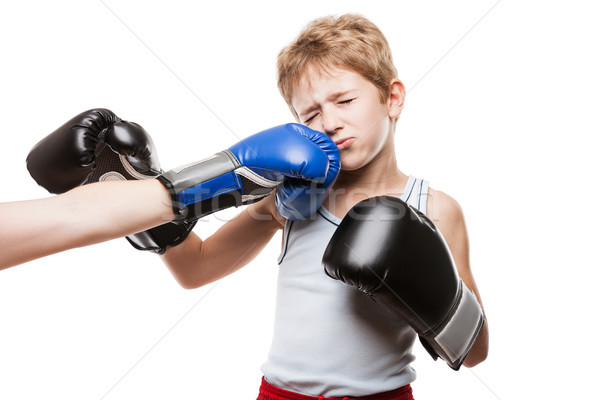 Handsome boxer child boy training boxing sport got punched Stock photo © ia_64