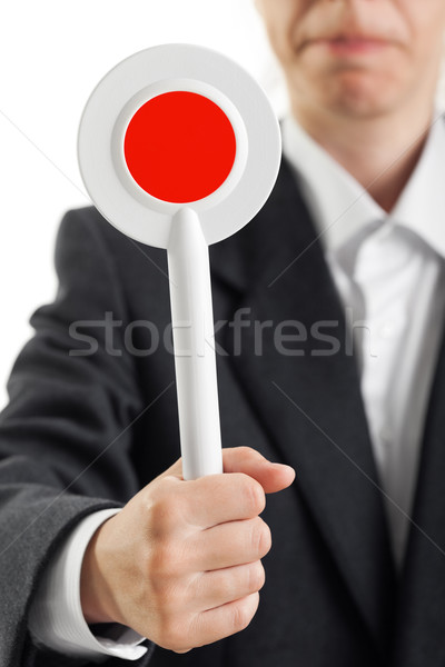 Stock photo: Auction paddle or voting card in hand