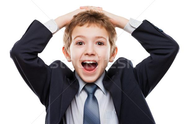 Meglepett meglepődött gyermek fiú üzlet öltöny Stock fotó © ia_64
