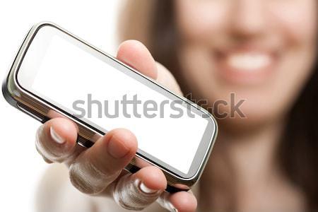 Mobiltelefon nők kéz mosolyog tart mobil Stock fotó © ia_64