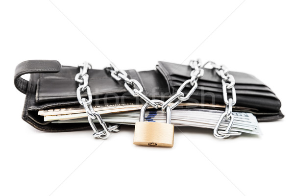 Chain padlock on leather wallet full of dollar currency money Stock photo © ia_64