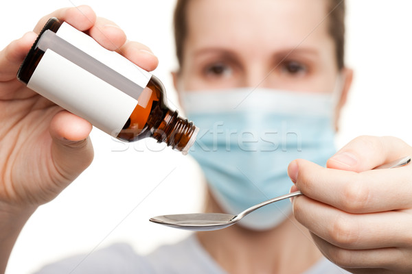 Doctor in mask holding medicine syrup Stock photo © ia_64