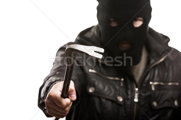 Criminal thief or burglar man in balaclava or mask holding crowb Stock photo © ia_64