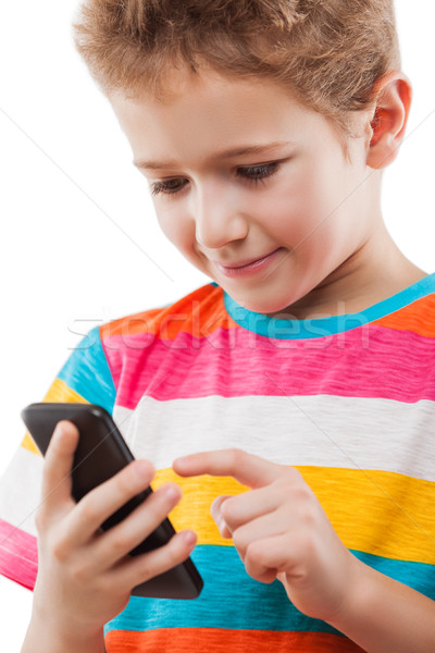Smiling child boy talking mobile phone or smartphone Stock photo © ia_64