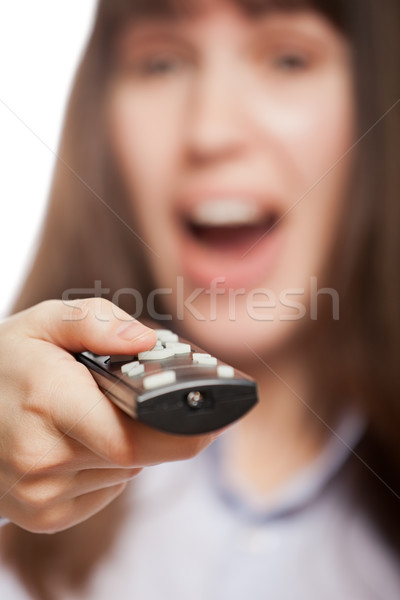 Woman hand holding tv channel remote control Stock photo © ia_64