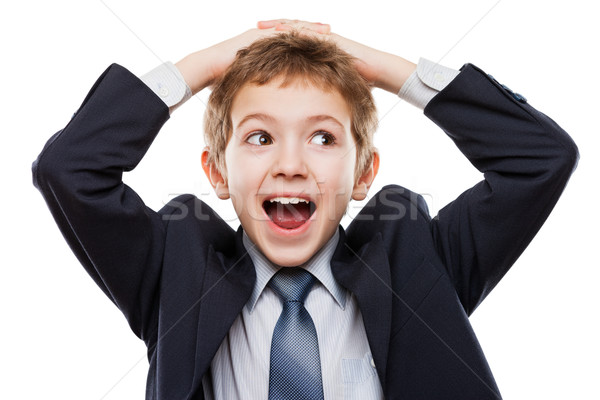 Amazed or surprised child boy in business suit holding hairs on  Stock photo © ia_64
