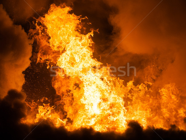 Burning fire flame on wooden house roof Stock photo © ia_64