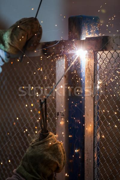 Arc welder worker in protective mask welding metal construction Stock photo © ia_64