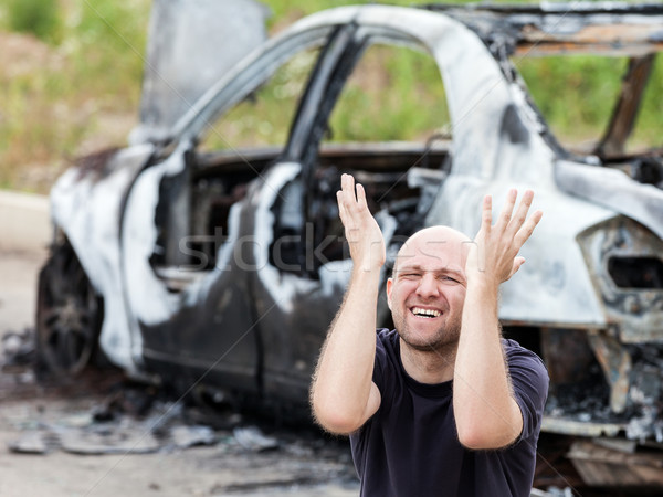 Crying upset man at arson fire burnt car vehicle junk Stock photo © ia_64