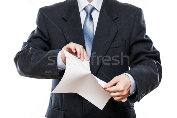 Angry businessman hand tearing paper document Stock photo © ia_64