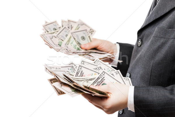 Businessman in black suit hand holding US dollar currency money Stock photo © ia_64