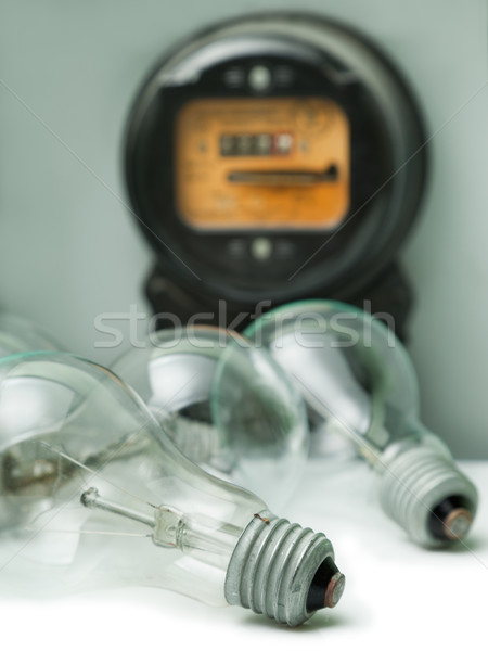 Lamp bulb and electricity supply meter Stock photo © ia_64
