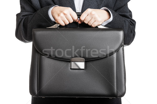 Businessman hand holding briefcase Stock photo © ia_64