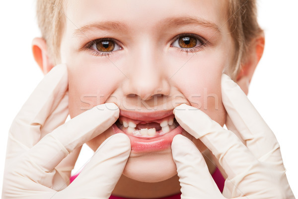 Dentist examining child teeth Stock photo © ia_64