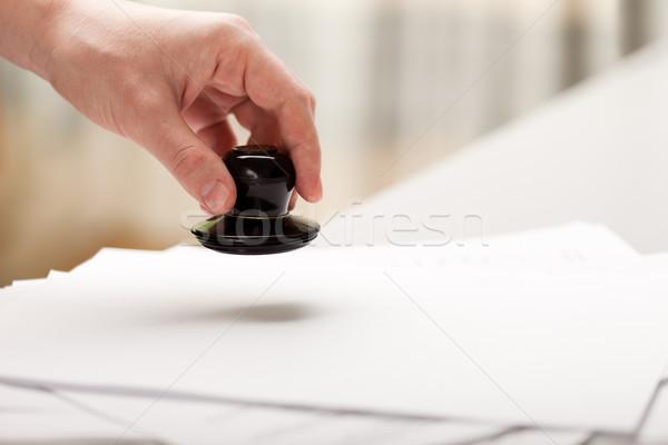 Mano sello papel documento oficina negocios Foto stock © ia_64