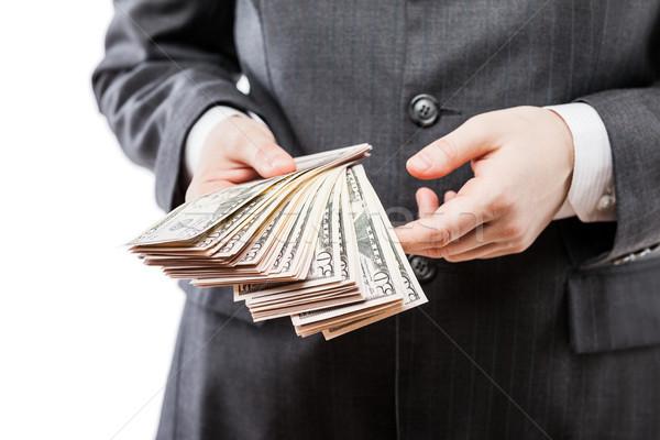 üzletember fekete öltöny kéz tart dollár valuta Stock fotó © ia_64