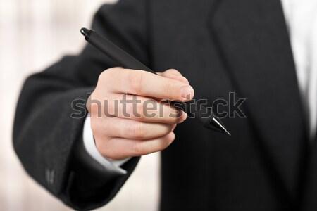 Hand holding ballpoint pen Stock photo © ia_64